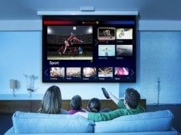 family watching television in living room myanmar iflix netflix broadband yangon 3G 4G fiber ftth